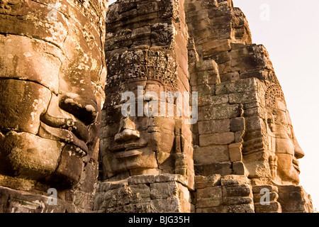 Cambodia Temples of Angkor The Bayon Tower with three huge carved faces - Stock Photo