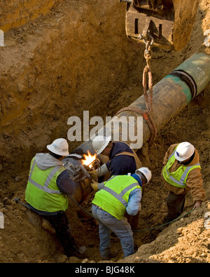 Construction equipment and personnel with varied skill sets are required for gas pipeline construction in Texas's - Stock Photo