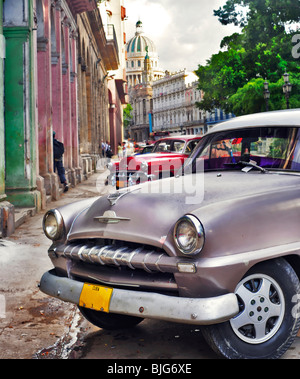 Detail of classic american car with havana buildings in the background - Stock Photo
