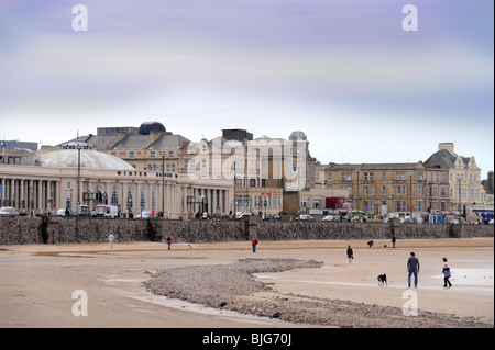 General view of the beach at Weston-Super-Mare with the Winter Gardens on the seafront UK - Stock Photo