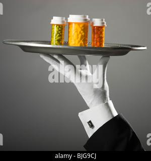 prescription drugs on a platter - Stock Photo
