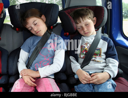 boy and sister asleep in car backseat stock photo royalty. Black Bedroom Furniture Sets. Home Design Ideas