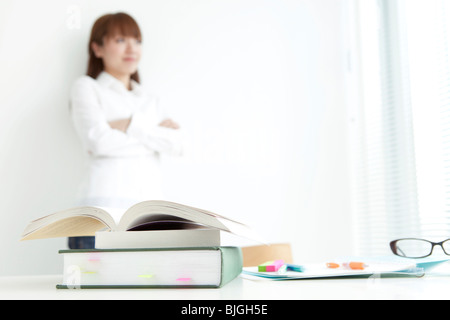 Young woman takes a break from studying - Stock Photo