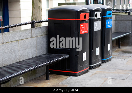 A row of recycling bins in a town centre - Stock Photo
