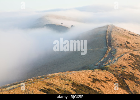 Low cloud & mist rolls over the Great Ridge, Loose Hill & Back Tor in the Peak District National Park as first light - Stock Photo