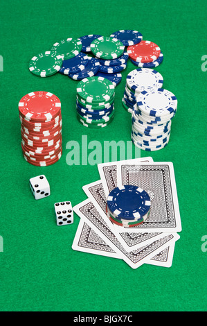 A setting of a poker game shows cards down and bet placed on top of the cards. - Stock Photo