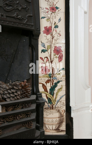 Decorative tiles forming part of a Victorian cast-iron fireplace - Stock Photo