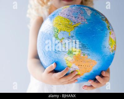 little girl holding a globe - Stock Photo