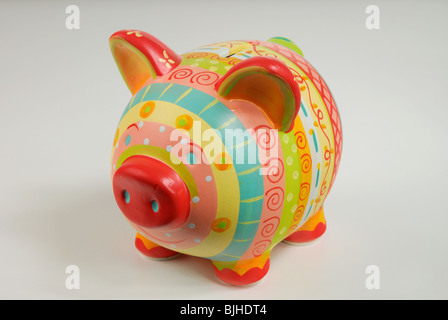 A colourful, cheerful and rather kitsch piggy bank. - Stock Photo