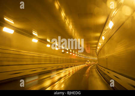 Cars driving in a tunnel - Stock Photo