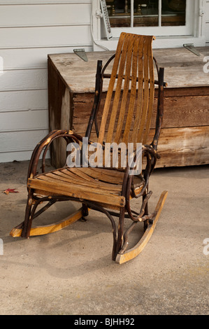 Bentwood Rocking Chair With Wooden Chest On The Porch Of A Rural Farmhouse  In The USA