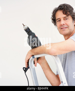 Man holding a drill - Stock Photo