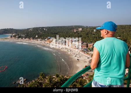 India, Kerala, Kovalam, tourist enjoying elevated view of beach from top of Vizhinjam Lighhouse - Stock Photo