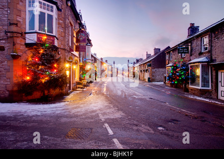 Christmas lights in Castleton at dusk in the Peak District national Park - Stock Photo