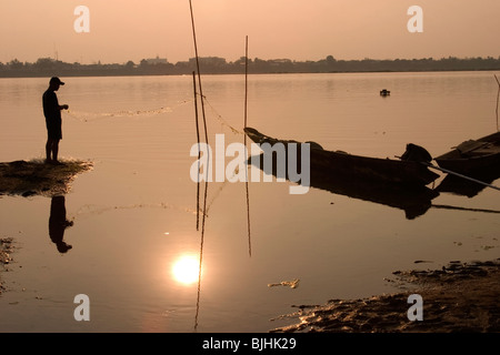 A fishermen on the shores of the Mekong River at Savannakhet, Lao People's Democratic Republic. - Stock Photo