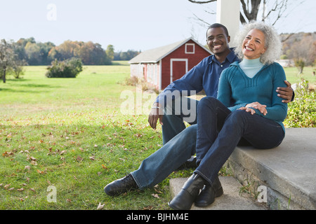 Couple sitting on porch - Stock Photo