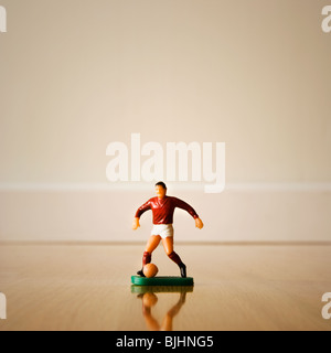 Figurine of a soccer player - Stock Photo
