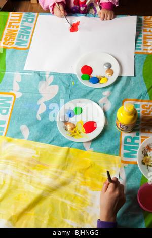 Children paint in nursery - Stock Photo
