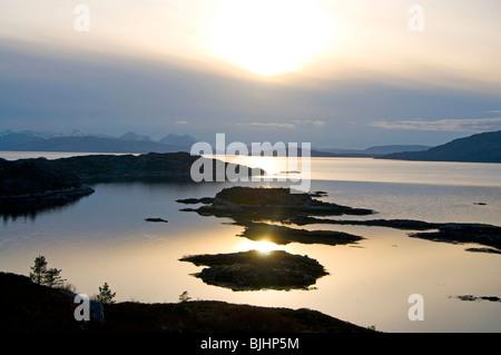 sunset and small islets by Plockton near Isle of Skye - Stock Photo