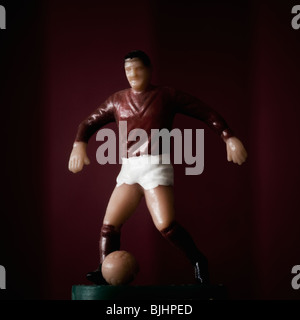 Figurine of soccer player - Stock Photo