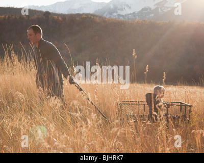 Father pulling son in wagon - Stock Photo
