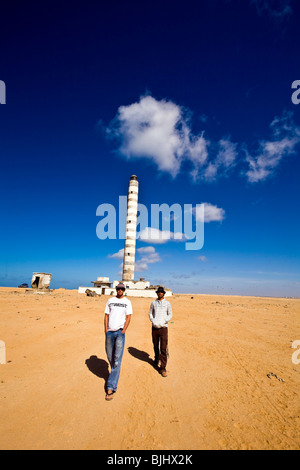 Western Sahara, Dakhla, Lighthouse, men walking in Desert. - Stock Photo