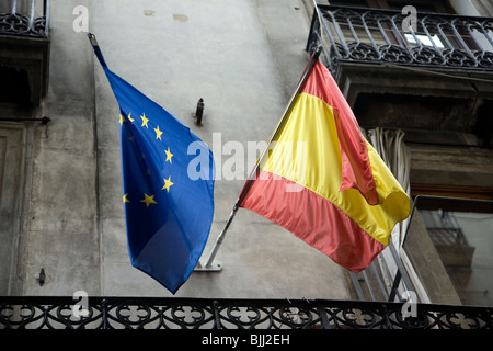 Euro and Spanish Flags on building in Barcelona - Stock Photo