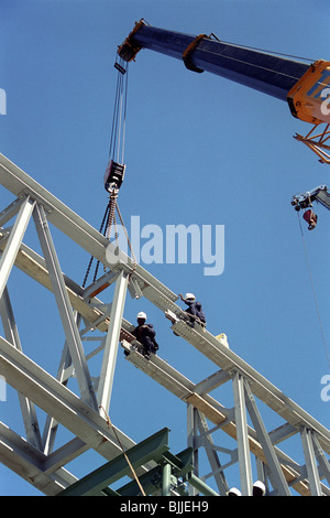 african construction workers assembling steelwork - Stock Photo