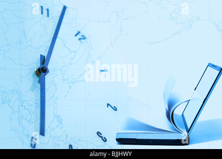 Laptop computer combined with book and clock against world map - Stock Photo