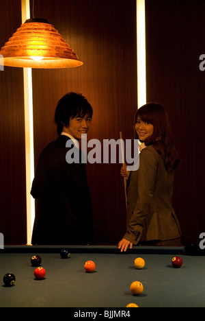 Business colleagues standing next to a pool table - Stock Photo