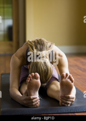 Woman doing yoga - Stock Photo