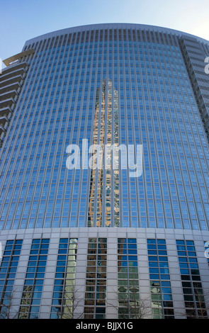 Messeturm tower reflected in the windows of Commerzbank, Frankfurt Trade Fair, Hesse, Germany, Europe - Stock Photo