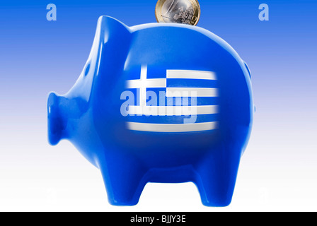 Piggy bank with a Greek flag and euro coin, symbolic for Greece's saving policy - Stock Photo