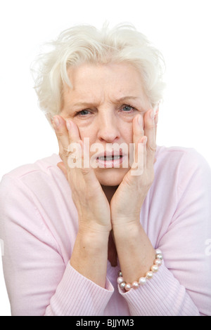 Woman holding her hands in horror at her face - Stock Photo