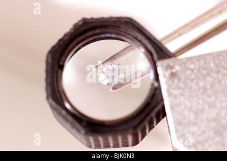 Gemstone Through a Loupe - Stock Photo