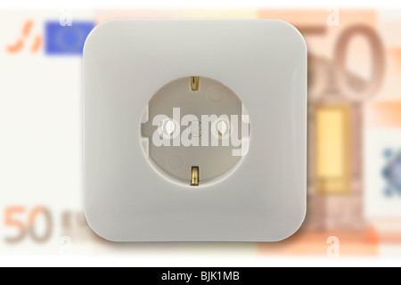 Electric socket and a 50 euro banknote, symbolic image for high electricity costs - Stock Photo
