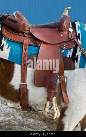 An image of a western style leather saddle. - Stock Photo