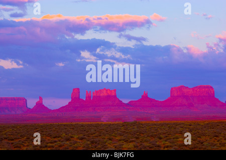 Monument Valley Tribal Park, Utah, The Bear, Stagecoach and other pinnacles, Sunrise - Stock Photo