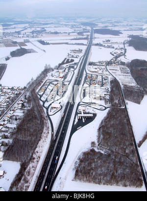 Aerial photo, Rhynern, A2 Autobahn, highway petrol station and rest stop, snow-covered, Hamm, Ruhr area, North Rhine - Stock Photo