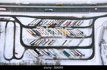 Aerial photo, Rhynern, A2 Autobahn, highway petrol station and rest stop, snow-covered truck parking area, Hamm, - Stock Photo