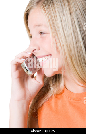Girl talking on cell phone smiling - Stock Photo
