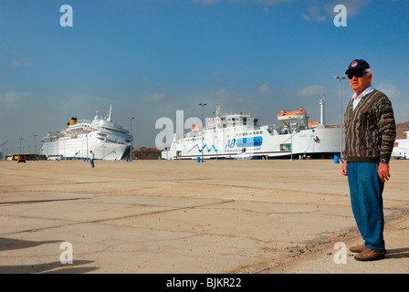 Listing COSTA EUROPA cruise ship after crashing into the quay, passengers evacuated without luggage, pier of Sharm - Stock Photo