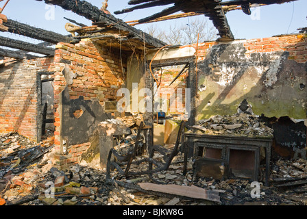 Burnt out house following serious house fire showing extensive damage - Stock Photo