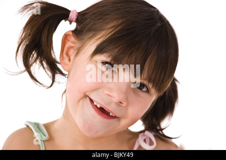 Little girl with pigtails - Stock Photo