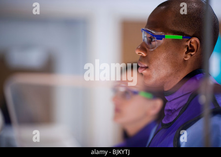Male x-ray technician wearing protective glasses - Stock Photo