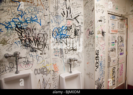 Detroit, Michigan - Graffiti covers the walls of a rest room at Honest ? John's Bar and No Grill. - Stock Photo