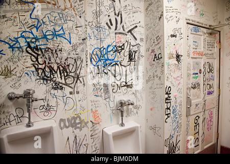 Detroit, Michigan - Graffiti covers the walls of a rest room at Honest ? John's Bar and No Grill.