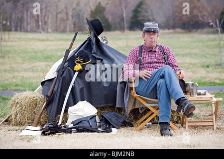 Reenactor of the 7th Tennessee Cavalry, Company C during a gathering at Parkers Crossroads, Tennessee. - Stock Photo