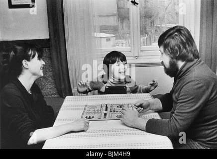 Family playing the Mensch-aergere-dich-nicht board game, East Germany, Europe, circa 1975 - Stock Photo