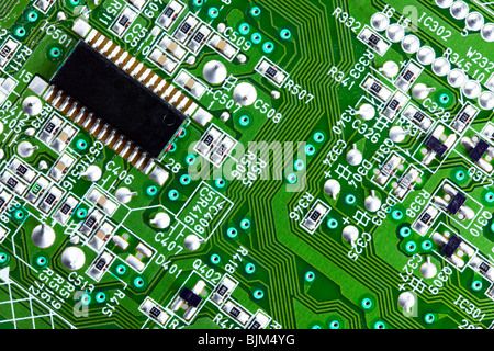 Macro shot of an electrical circuit board and computer chip - Stock Photo